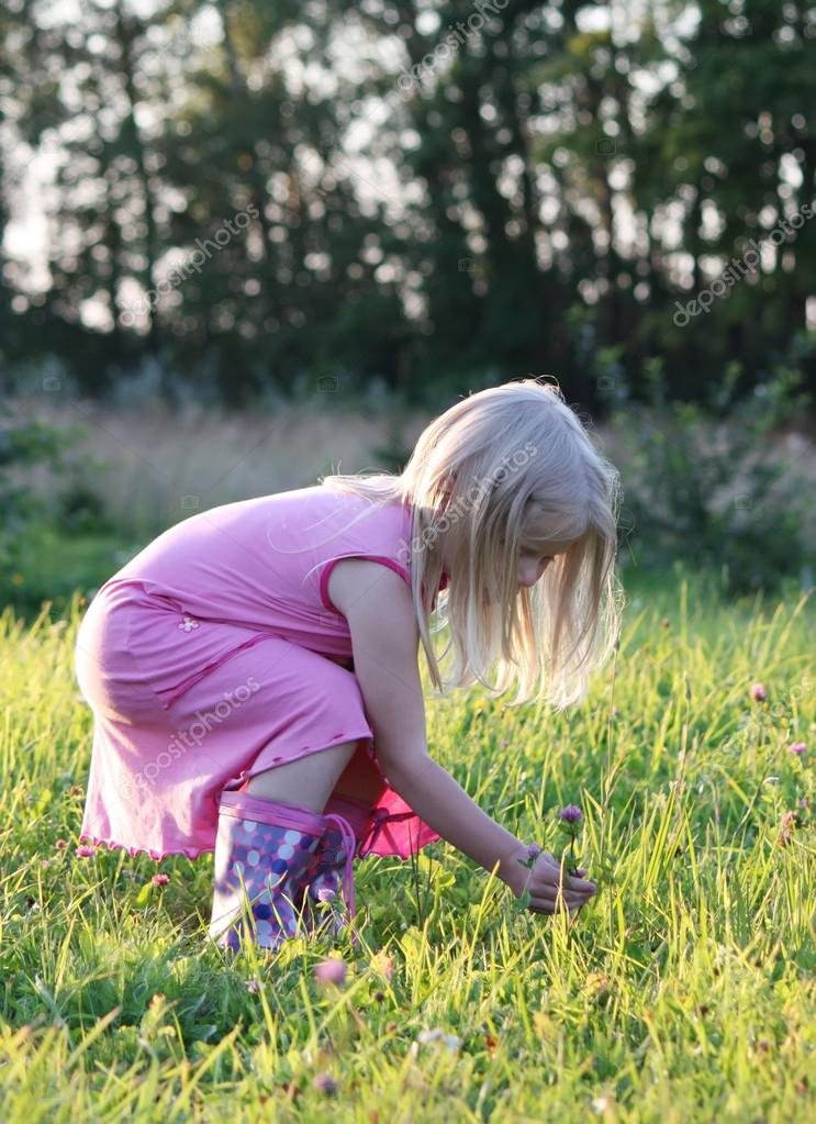 Little girl on a summer meadow