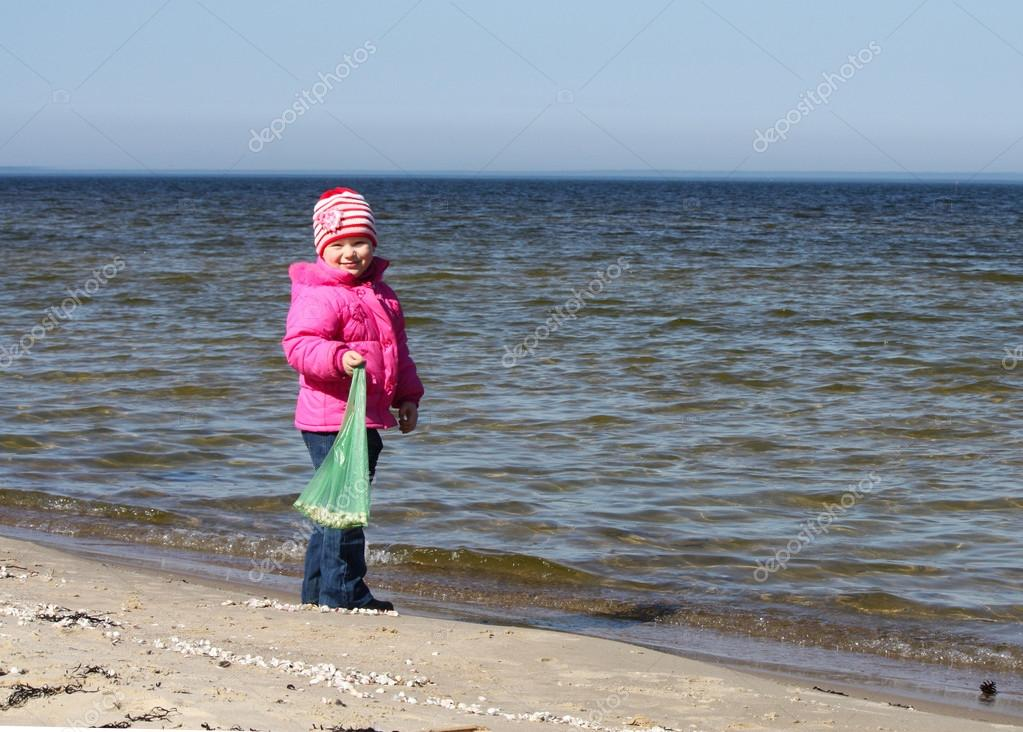 Blond girl on the beach