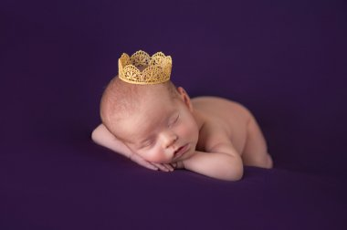 Newborn Baby Girl Wearing a Gold Crown