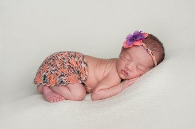 Newborn Baby Girl in Mini Skirt