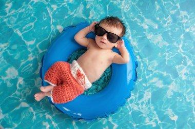Newborn Baby Boy Floating on an Inner Tube