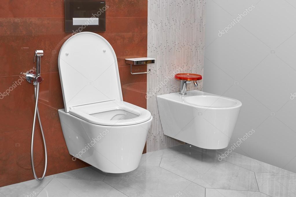 toilet and bidet in a modern bathroom stock photo himchenko 121969232. Black Bedroom Furniture Sets. Home Design Ideas