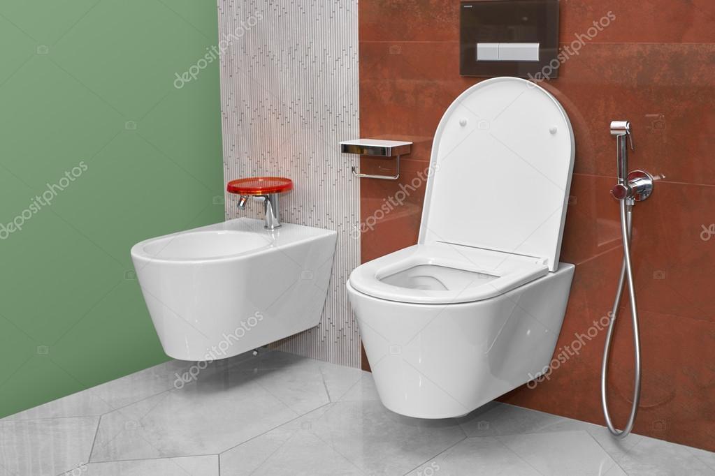 toilet and bidet in a modern bathroom stock photo himchenko 121969462. Black Bedroom Furniture Sets. Home Design Ideas