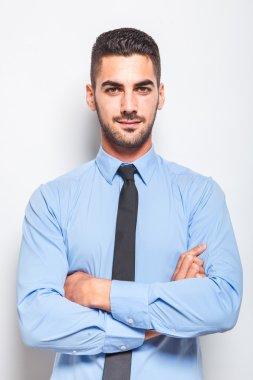 single elegant man in blue shirt with black tie
