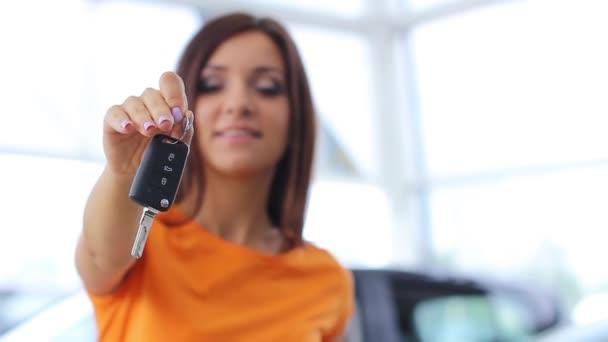 Girl selling car at car sales center (PAL)