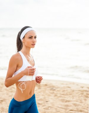 Young woman on beach doing exercises