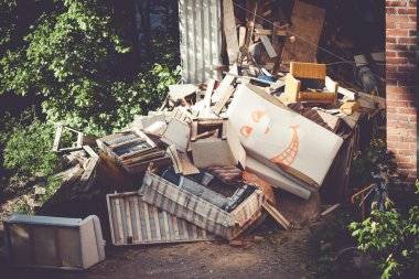 Funny broken furnitures trash pile
