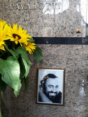 MODENA, ITALY, APRIL 2 2016, Tomb of Luciano Pavarotti, famous tenor, ceramic portrait