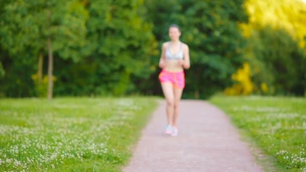 Beautiful young sport girl engaging in gymnastics outdoors. Runner - woman running outdoors training for marathon run