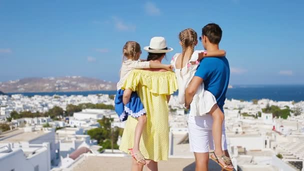 Family in Europe. Parents and kids background the old town in Mykonos  island, Greece — Stock Video © d.travnikov #123987208