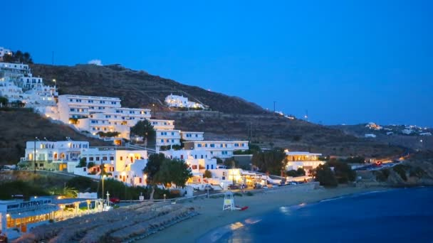 View of traditional greek village with white houses in night lights on Mykonos Island, Greece,