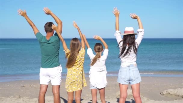Young family on summer beach vacation