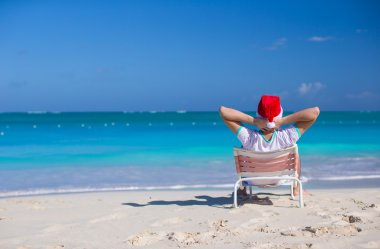 Young man in santa hat during beach vacation