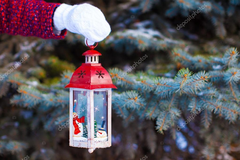 Closeup of hand holding beautiful vintage Christmas lantern