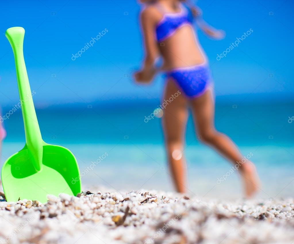 Summer kids beach toy in the white sand