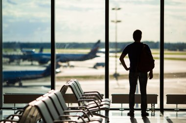 Silhouette of a man waiting to board a flight in airport