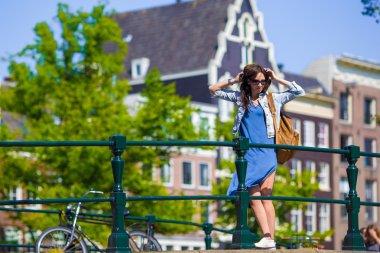 Young beautiful woman walking in european city, Amsterdam, Holland