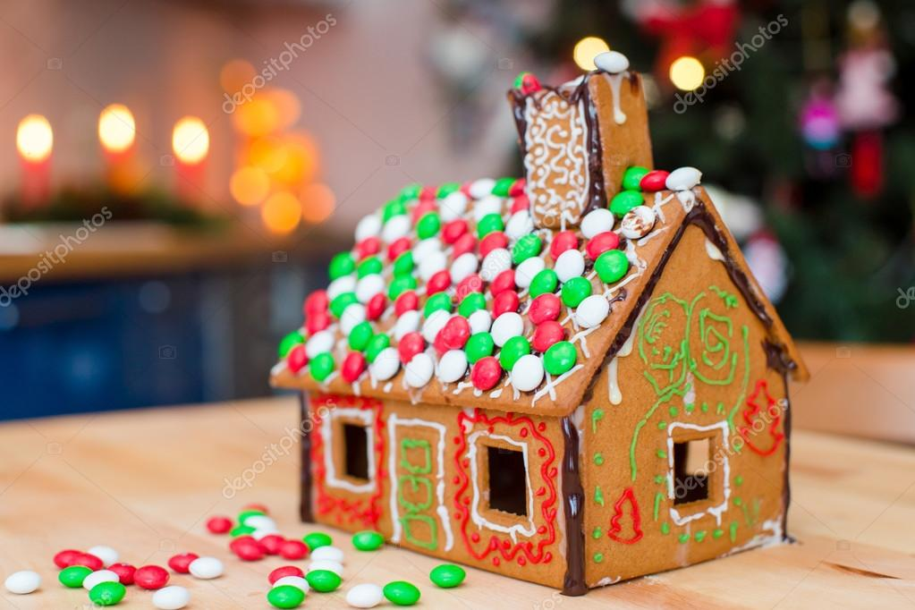 Christmas Gingerbread House Background.Gingerbread House Decorated With Colorful Candies Background