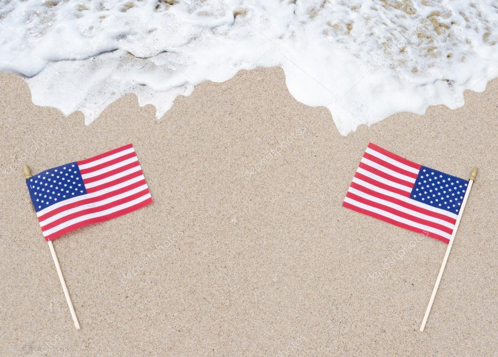 American flags on the sandy beach