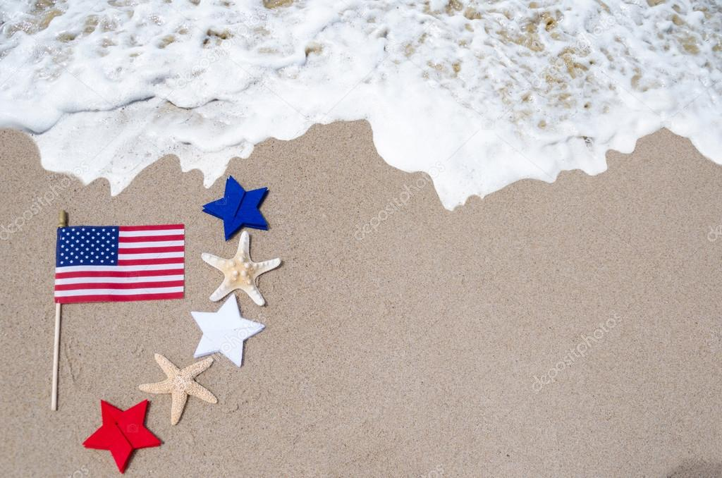American flag with starfishes on the sandy beach