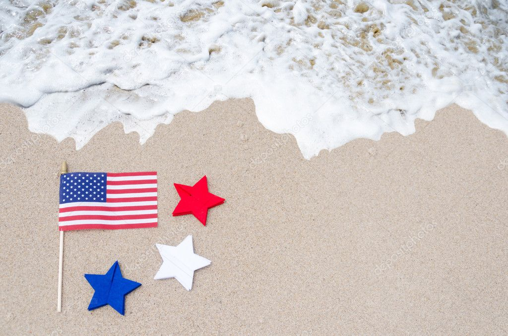 American flag with stars on the sandy beach