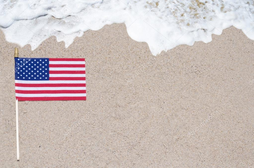 American flag on the sandy beach