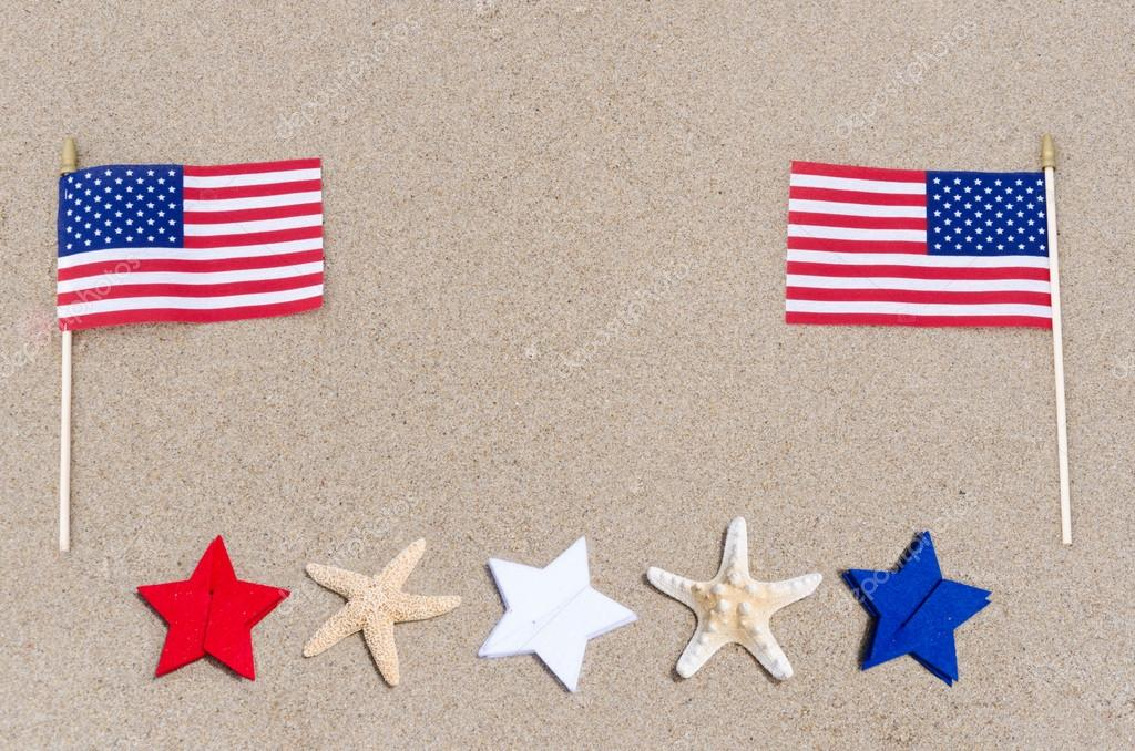 American flags with starfish on the sandy beach