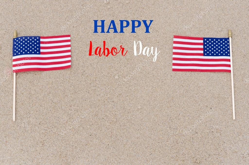 Happy Labor Day background with flags on the sandy beach