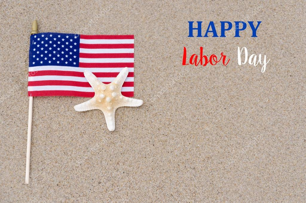 Happy labor day background with flag, starfish on the sandy beac