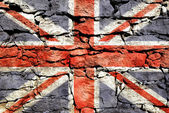Texture of stone wall with a picture of Union Jack.