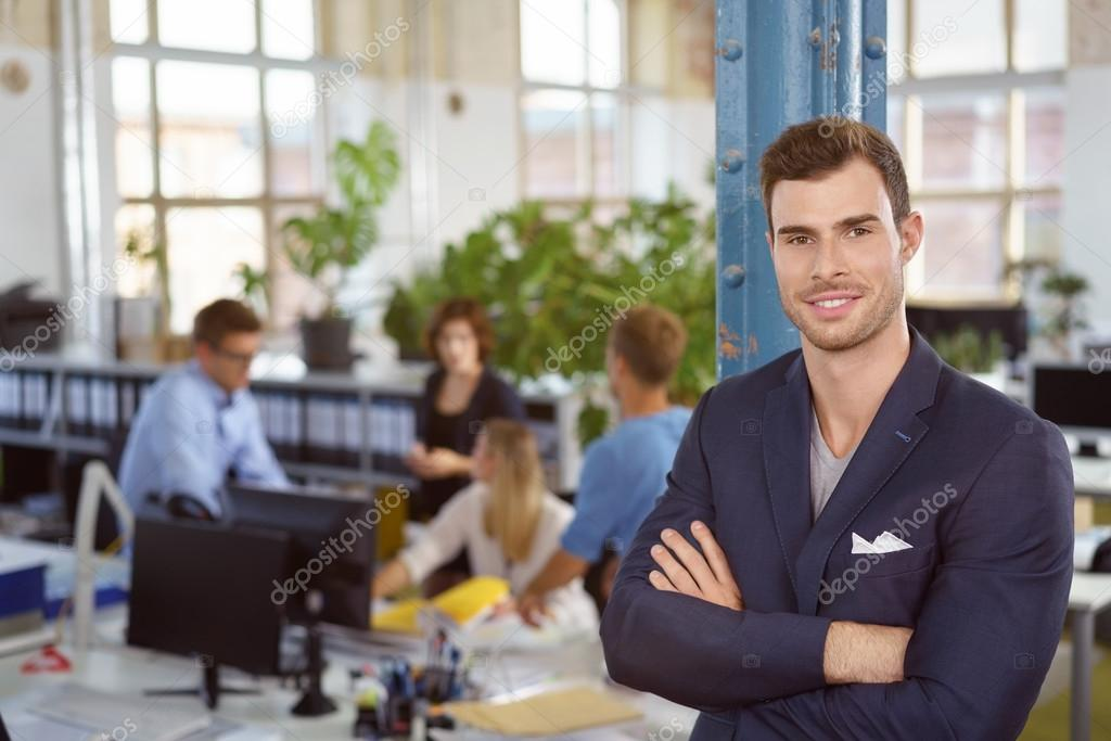 Self Assured Businessman With A Friendly Smile Stock Photo
