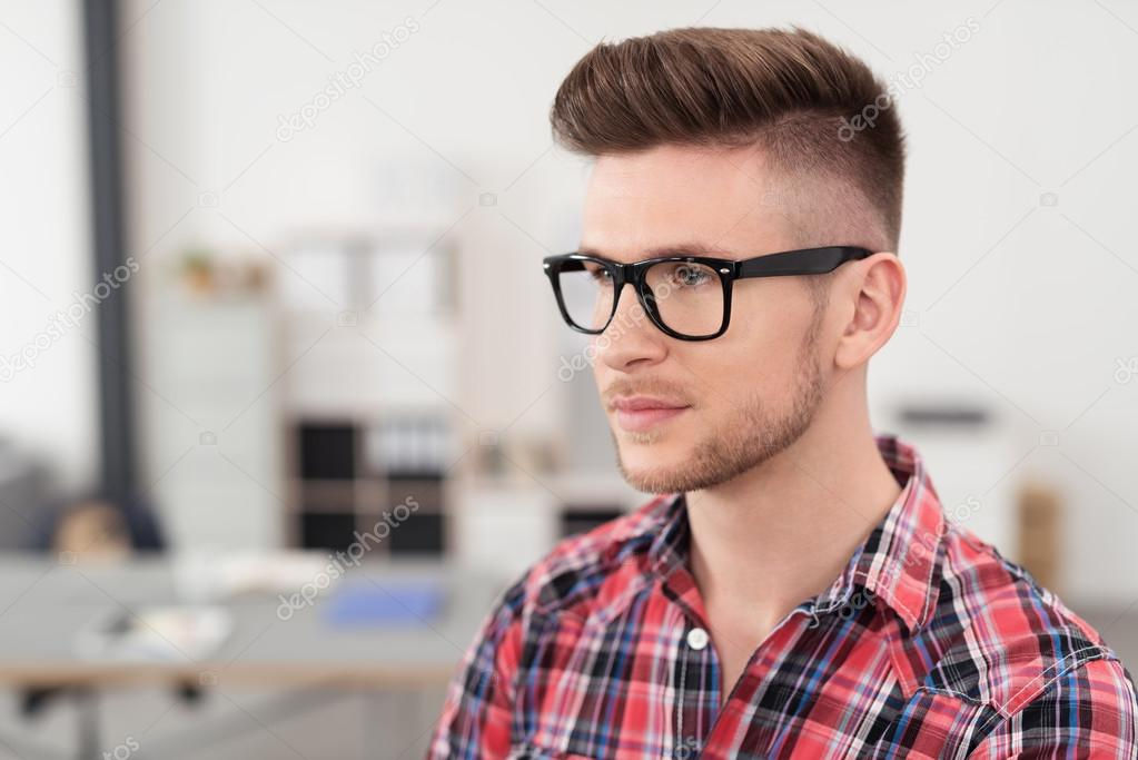 3bebd81ad2e Serious Young Man with Glasses Inside the Office — Stock Photo ...