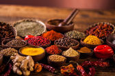 Photo Wooden table of colorful spices