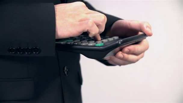 Man in Suit typing on Calculator