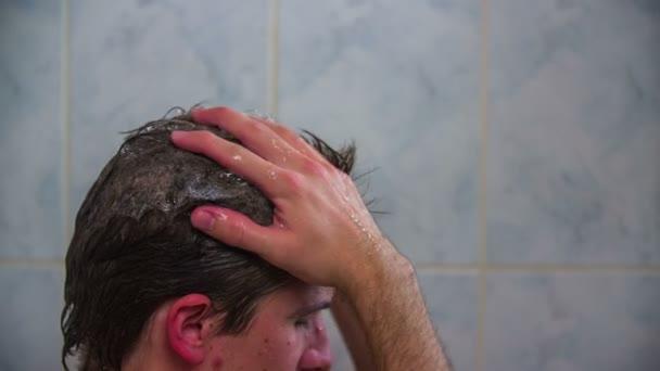 Washing hair with shampoo