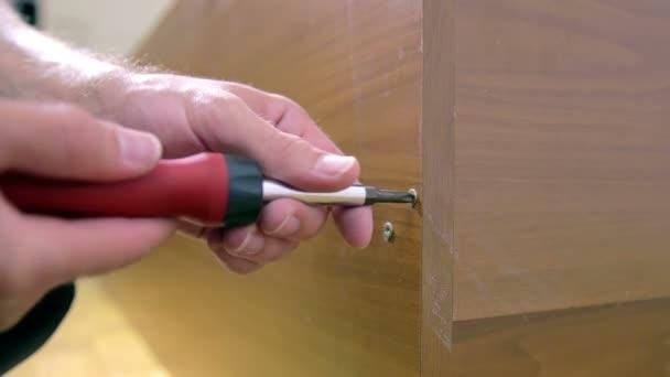 Man Removing screw