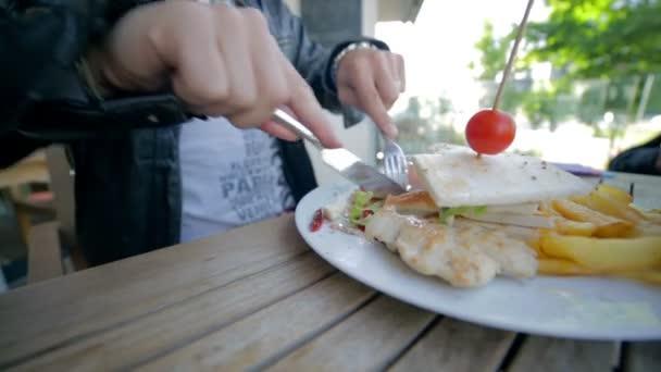 Man cutting sandwich