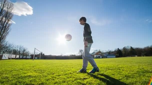 Boy Juggling soccer ball