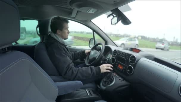 man driving in new car