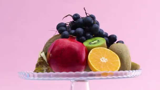 Fast rotating and slow down various kind of fresh ripe fruits on glass crystal bowl