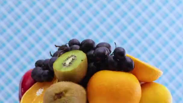 Fast and slow down rotating group of various kind of fresh and ripe fruits