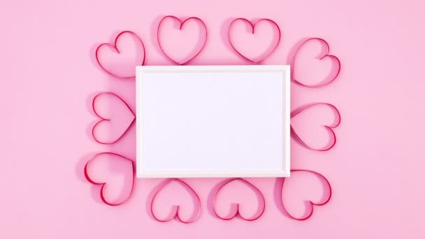 Romantic Valentines day hearts surround white frame for text. Stop motion