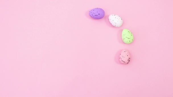 Easter eggs and feathers make circle with place for text. Stop motion