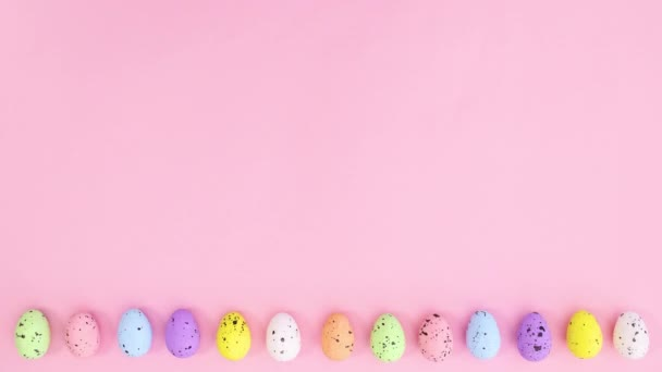 Easter eggs move on the bottom of pastel pink theme. Stop motion
