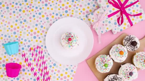 Party decoration with cup cakes move on pastel theme. Stop motion