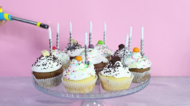 Put birthday candles on cup cakes with cream for party