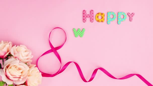Happy Womens day text appear with ribbons and flowers . Stop motion