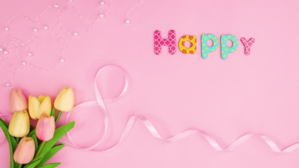 Happy womens day text appear on pastel pink theme with flowers. Stop motion