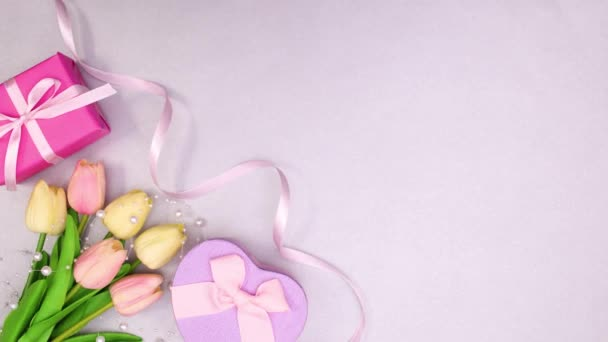 Gifts, flowers and ribbons move on left side. Stop motion