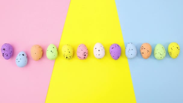 Colorful Easter eggs move one by one on colorful theme. Stop motion